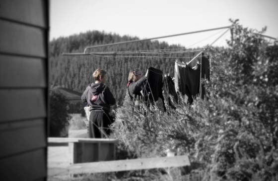 photo of mother and son hanging out washing